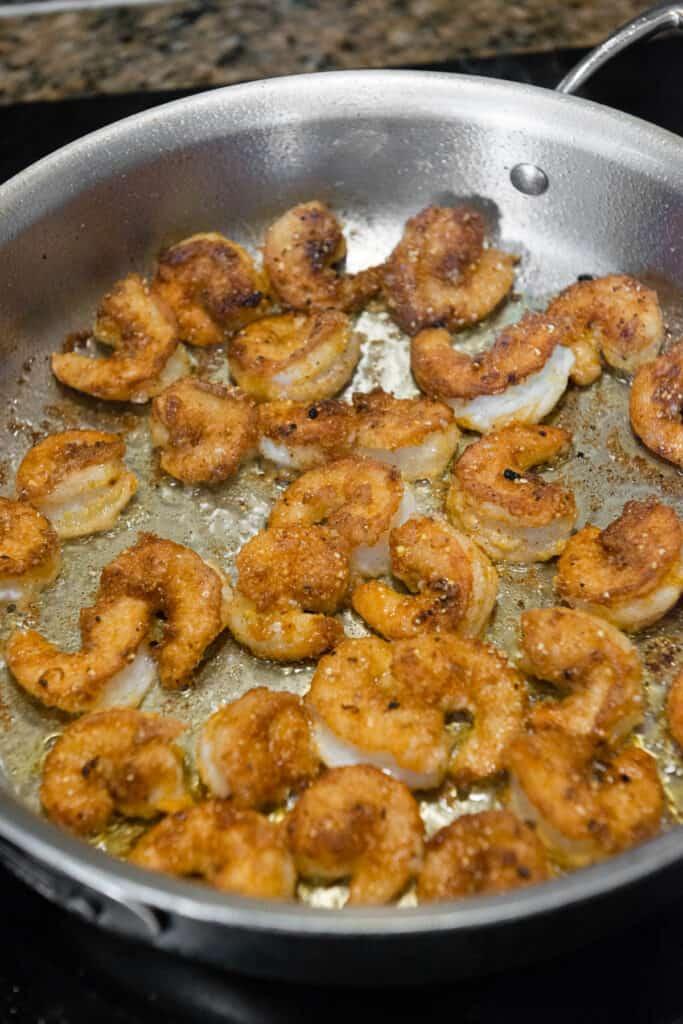 fried browned shrimp in pan