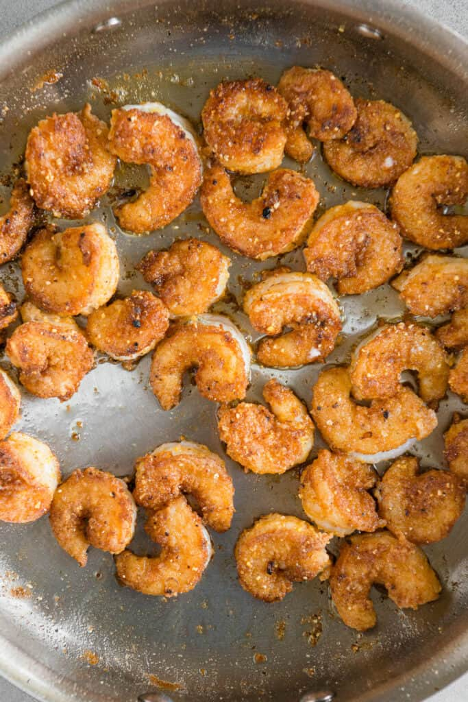 cooked fried breaded shrimp in pan