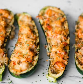 shrimp zucchini boats with artichoke and parmesan