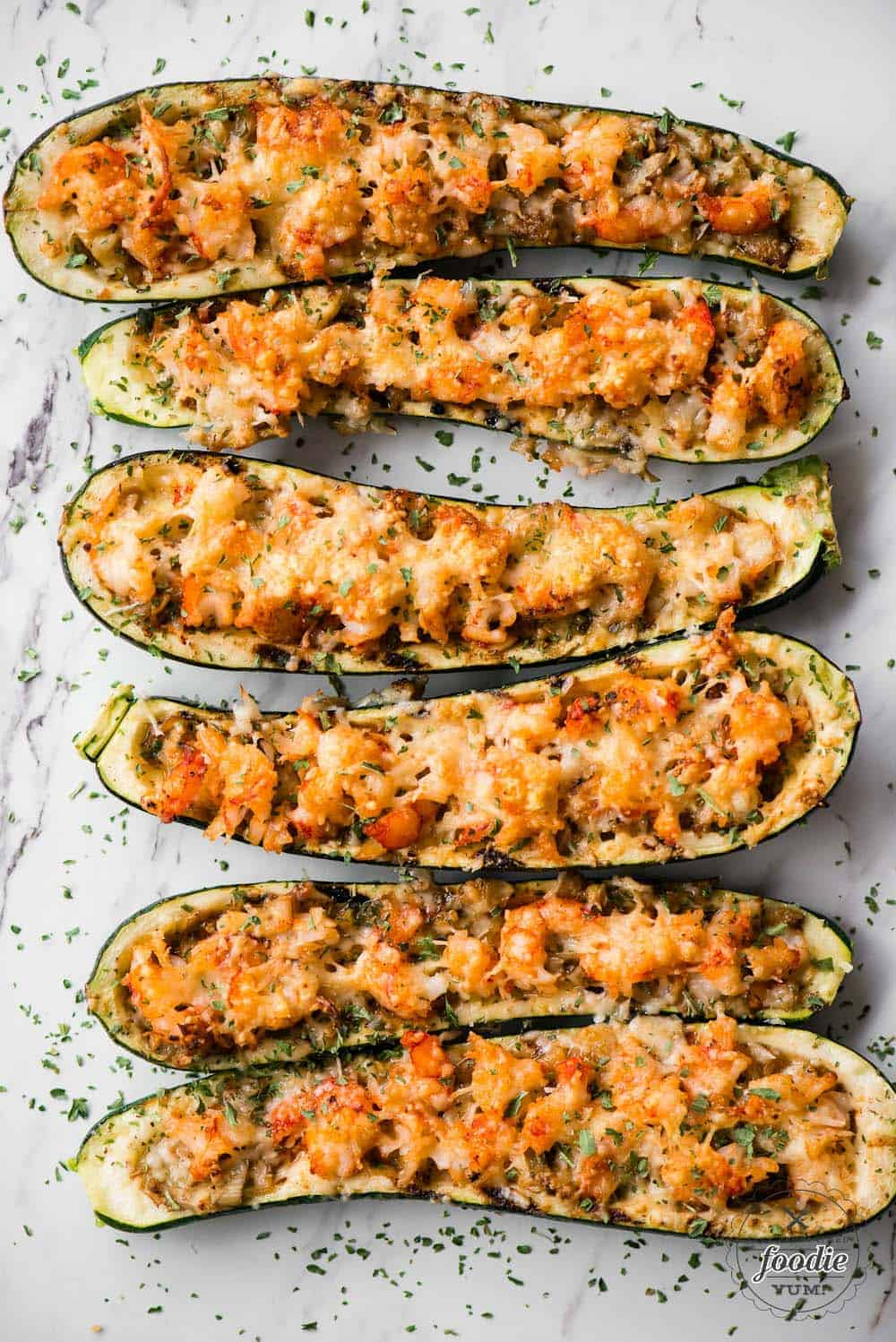 six shrimp zucchini boats with parmesan