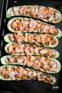 shrimp zucchini boats before they are baked