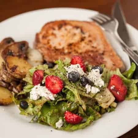 A delicious Simple Summer Salad with fresh greens, goat cheese, berries, and a homemade balsamic vinaigrette is the perfect side dish for lunch or dinner.