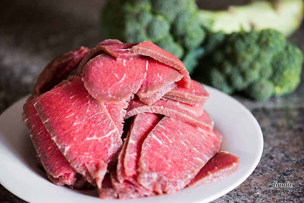 sliced partially frozen beef