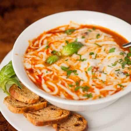Enjoy all the comfort of lasagna in this light and easy to make sausage, mushroom, spinach Slow Cooker Lasagna Soup topped with melted mozzarella cheese.