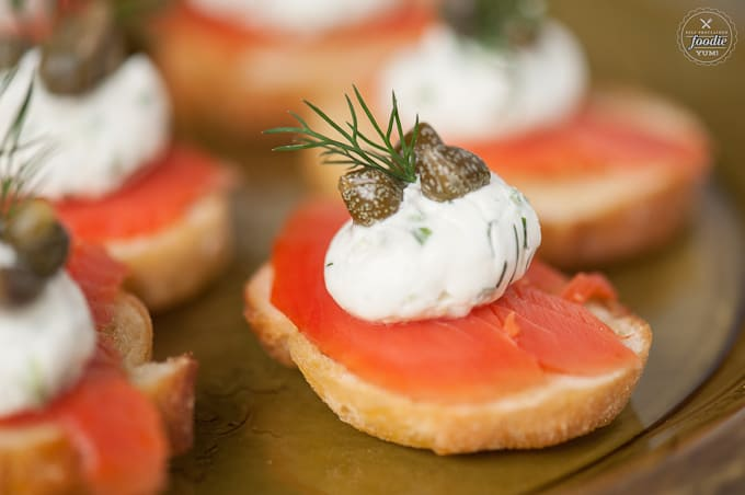 A close up a salmon crostini