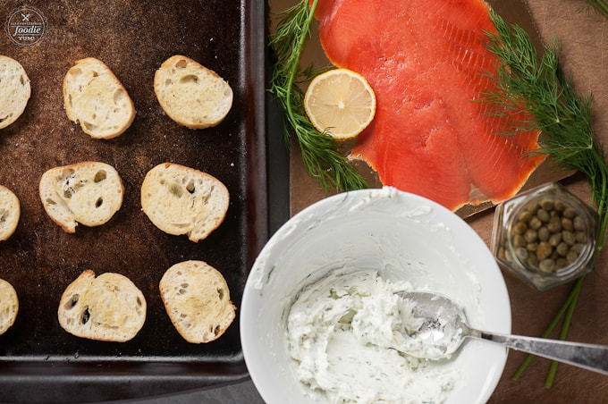 bread, salmon, and cream cheese on a table
