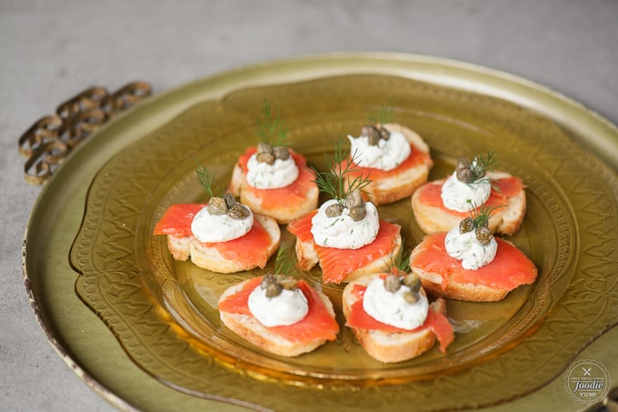 smoked salmon crostini on a gold dish