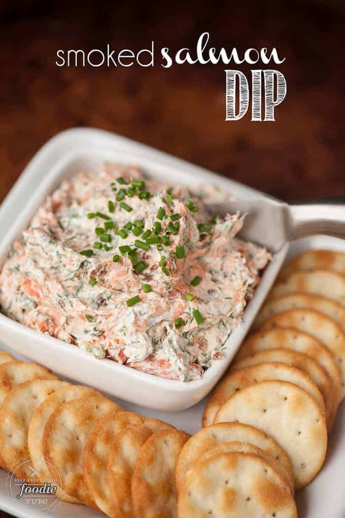 smoked salmon cream cheese dip in white square dish with crackers