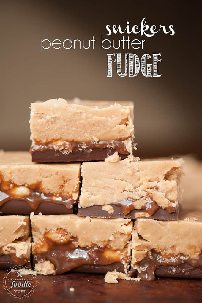 Stack of Microwave Snickers Peanut Butter Fudge with caramel, peanuts and chocolate
