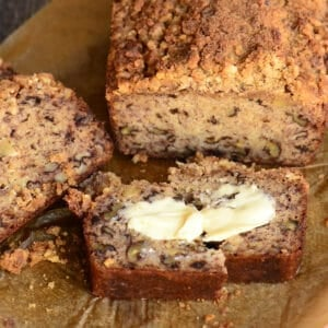 sliced homemade banana bread with butter