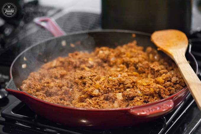 This spicy Southwestern Chili made with ground beef, chorizo, green chile, black and pinto beans is a hearty meal perfect for tailgating on game day!