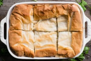 six cut pieces of spanakopita