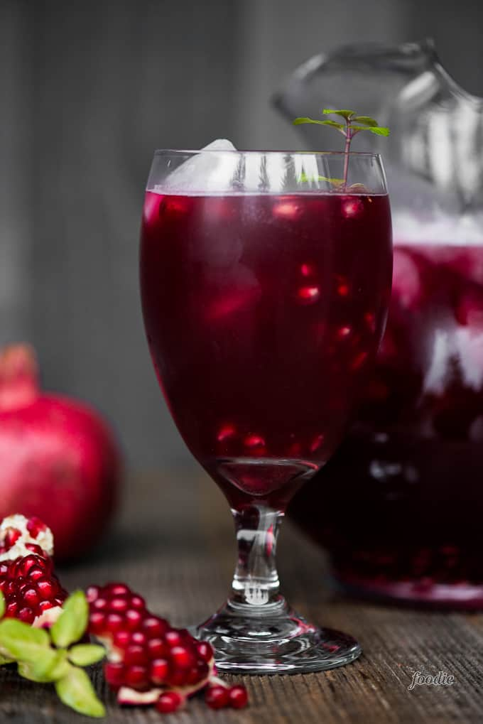 Alcoholic punch with vodka, prosecco, and pomegranate juice.