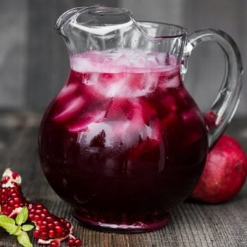 Pomegranate Vodka Punch is an easy sparkling party cocktail. Made with chilled pomegranate juice, fresh pomegranate arils, Prosecco, and sweetened with simple syrup and ginger ale, this party punch takes only minutes to make and serves a crowd.