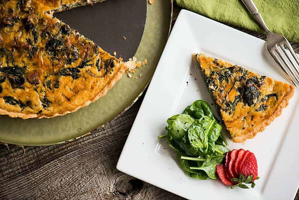Breakfast quiche with spinach and mushrooms