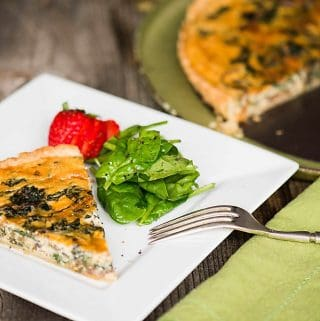 Mushroom Spinach Quiche is a rich and savory meal baked in an all butter pie crust. This homemade quiche recipe is perfect as breakfast or lunch when served with lightly dressed greens.