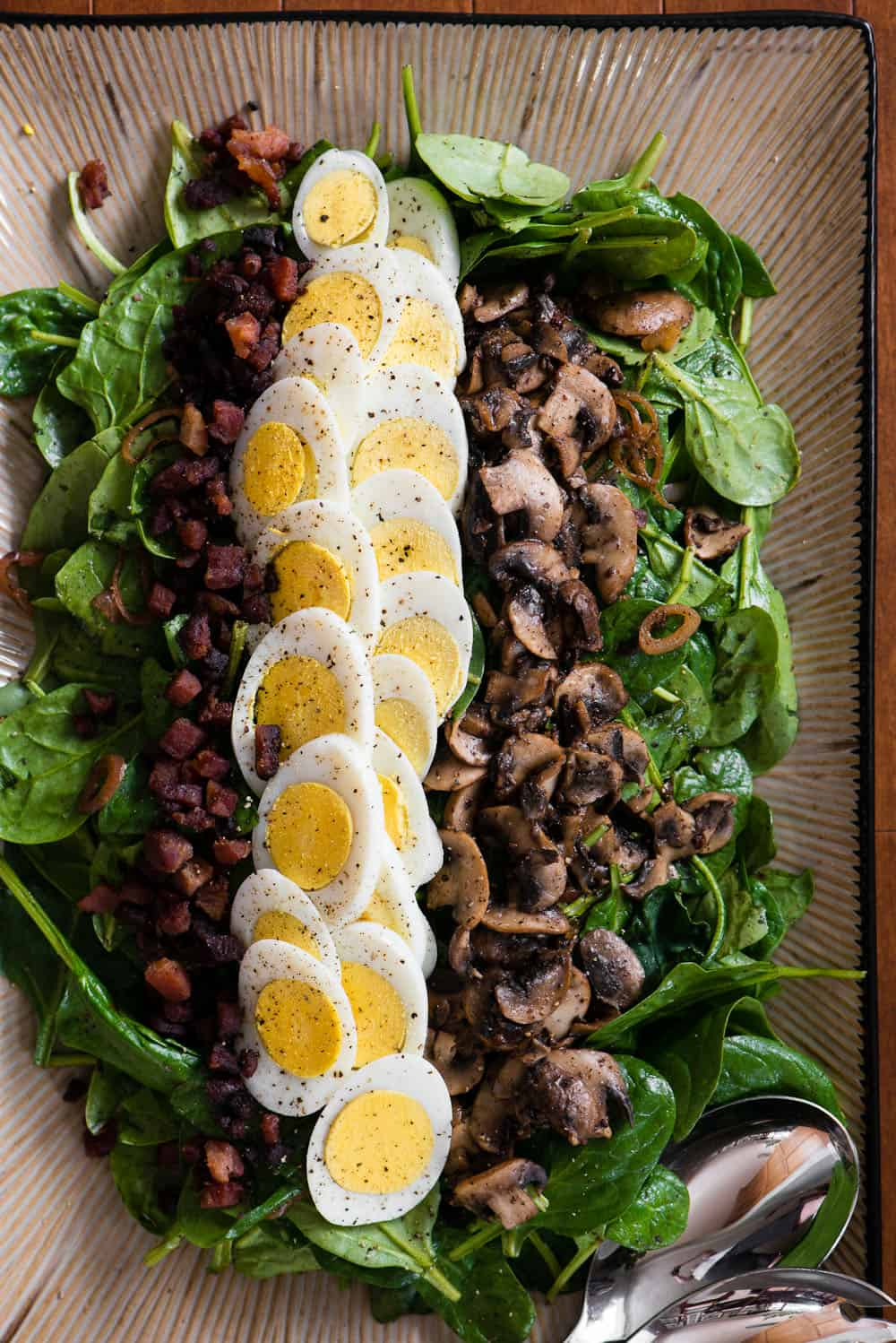 warm spinach salad recipe with bacon, eggs, mushrooms, and dressing