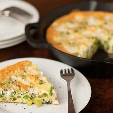 This savory organic Spring Vegetable Goat Cheese Frittata is a simple and quick mealtime solution that your family will love for breakfast or dinner!