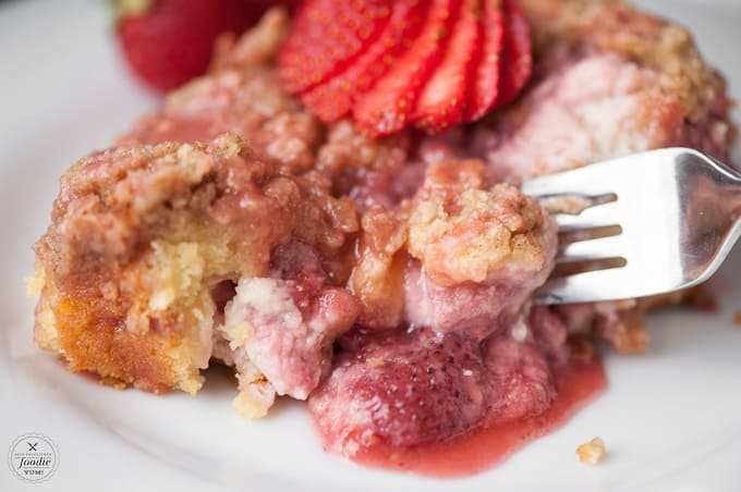 This layered Strawberry Cream Cheese Coffee Cake made with fresh strawberries, a cream cheese filling, and streusel topping is a delicious summer treat!