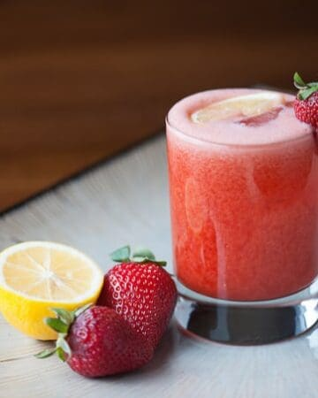This blended Strawberry Lemonade Whiskey Sour is perfectly tart and sweet with a bourbon whiskey kick is the perfect summertime cocktail.