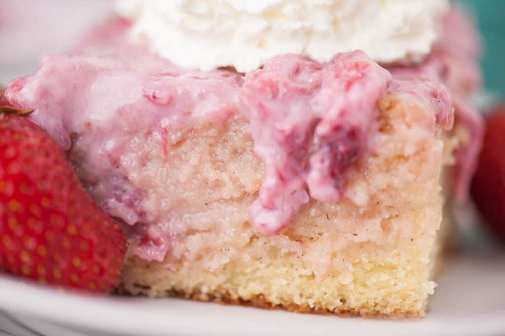 close up of vanilla cake with strawberry topping