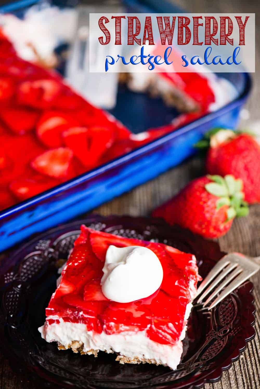 Strawberry Pretzel Dessertis the ultimate summer dessert, especially when you're looking for something sweet to take to potlucks! This tasty treat consists of a sweet pretzel crust, topped by a creamy layer, and finished off with a layer of fresh strawberries set in strawberry jello. #strawberry #strawberrypretzelsalad #strawberrypretzeldessert #strawberrypretzel #jello #dessert #potluck #strawberrypretzeljello #strawberrypretzelbars
