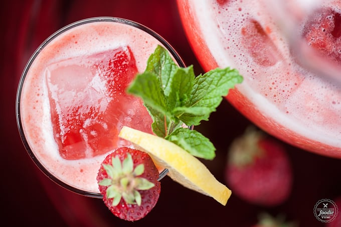 Strawberry Rhubarb Lemonade with strawberry, lemon and mint garnish