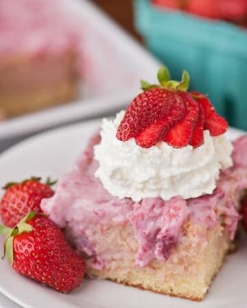 Fresh summer strawberries, sweetened condensed milk, and whipped cream transform a basic vanilla cake into a heavenly Strawberry Shortcake Poke Cake.