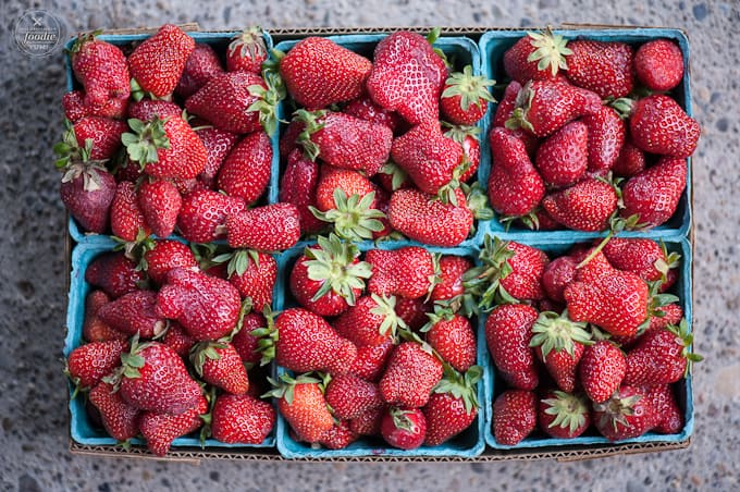 six cartons of strawberries
