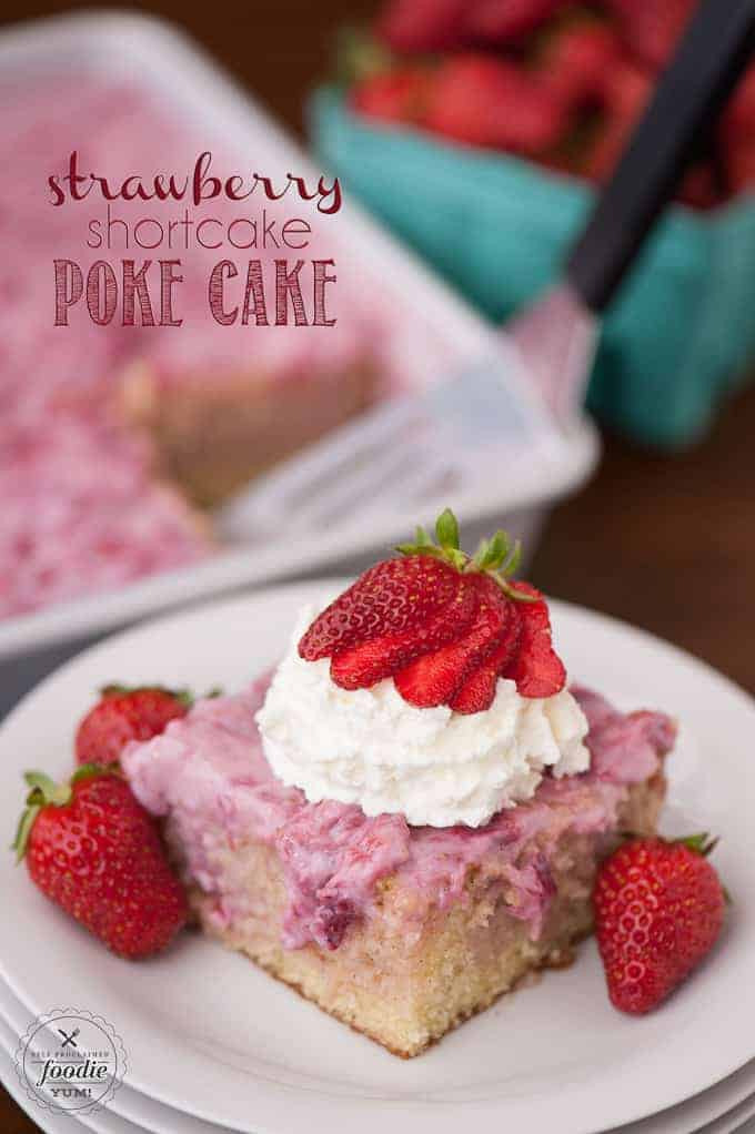 strawberry shortcake poke cake on a plate