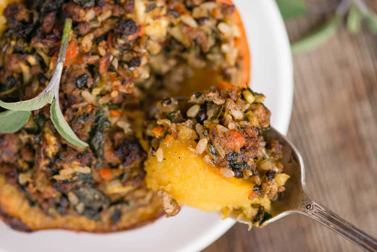 spoonful of Stuffed Acorn Squash with sausage