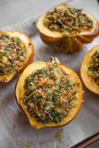 sausage and rice Stuffed Acorn Squash before they get baked in oven