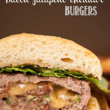 A close up of a stuffed bacon jalapeno cheddar burgers
