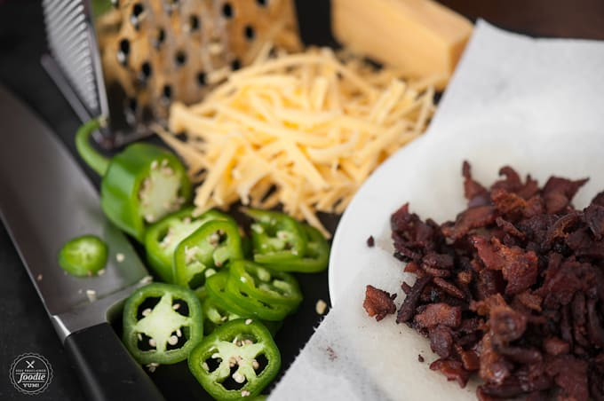 Why bother with toppings that slide right off your burger when the ultimate experience is these delicious grilled Stuffed Bacon Jalapeno Cheddar Burgers.