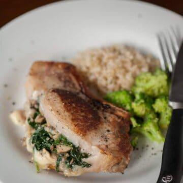 stuffed pork chop on plate with broccoli and rice