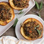 four roasted acorn squash halves stuffed with sausage and rice filling