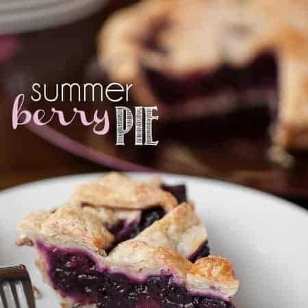 a slice of summer berry pie on a plate