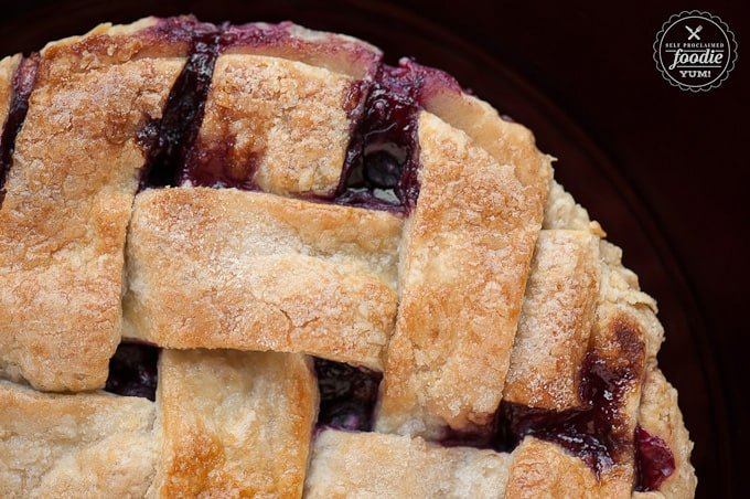 looking down at a summer berry pie with a lattice crust