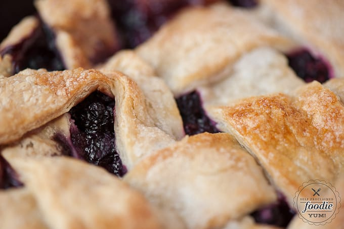 A close up of the top of a berry pie