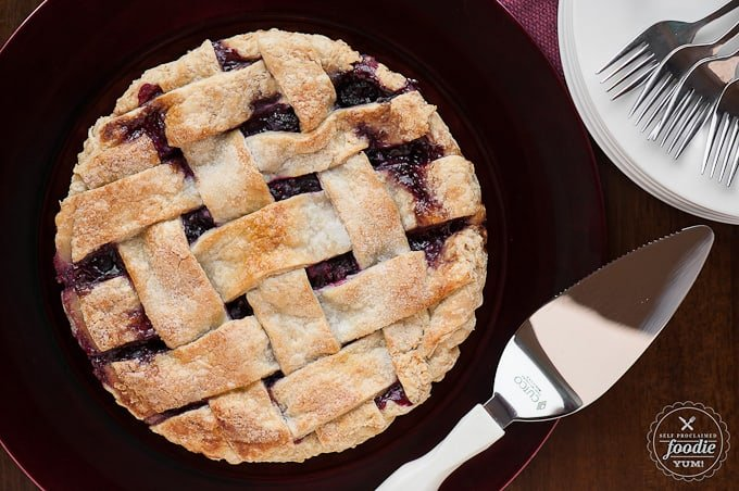 looking down at a whole berry pie with a lattice crust
