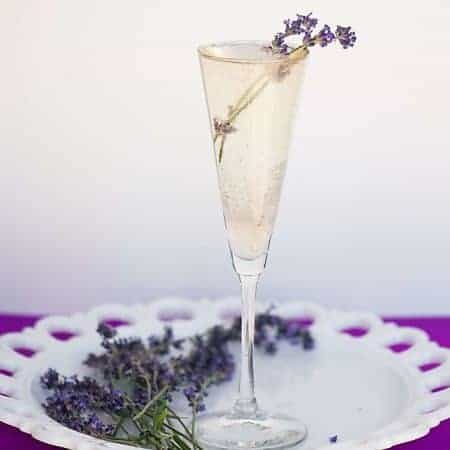Enjoy these sunny days with a refreshing Summer Lavender Prosecco - a cocktail made with a lavender infused simple syrup and light, fruity, Italian bubbles!