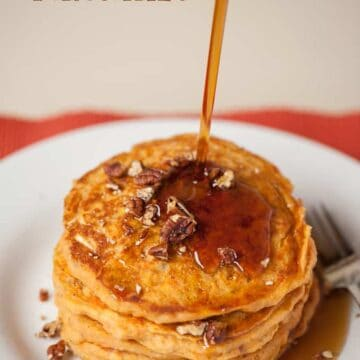 sweet potato pancakes with syrup being poured onto it