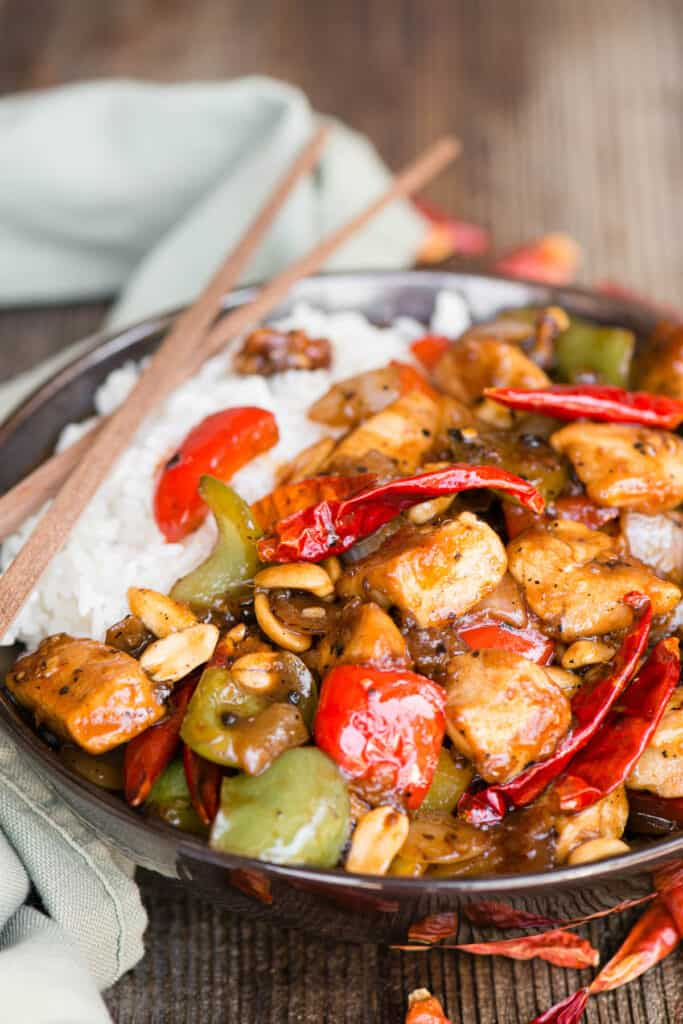Szechuan Chicken with peppers and sauce over rice