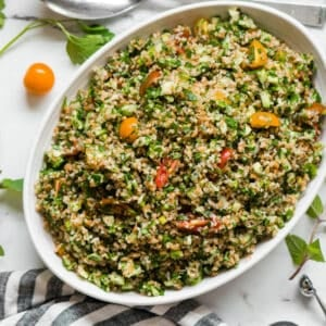 Tabouli mixed with fresh vegetables and herbs to make salad