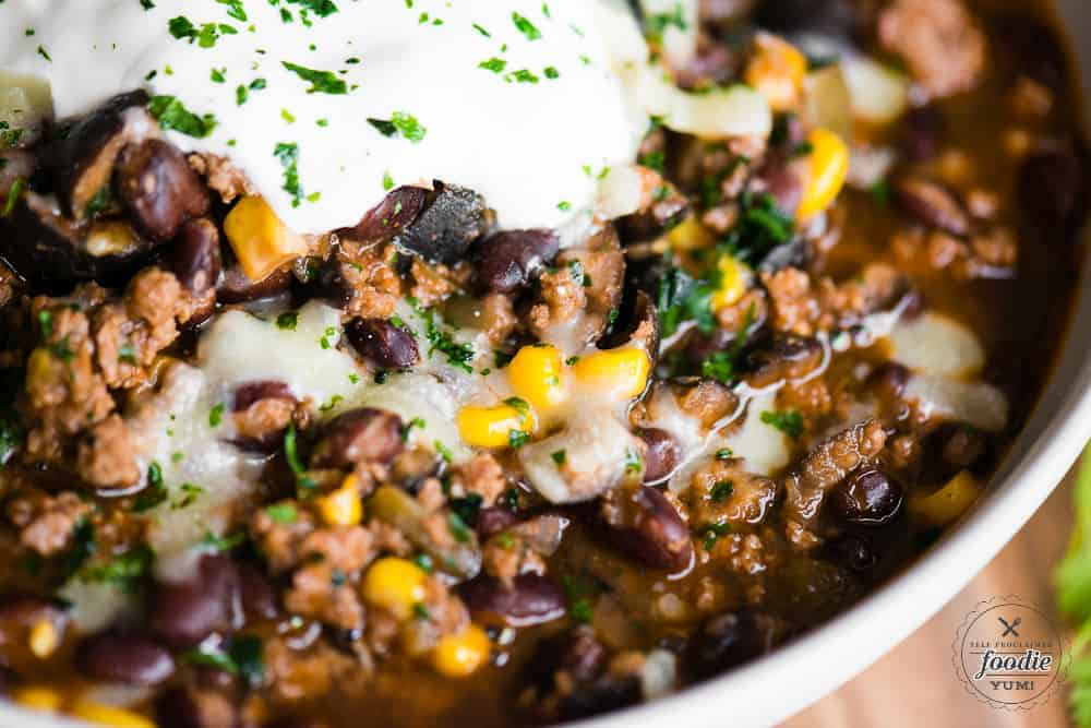 taco chili with meat, black beans, corn and olives