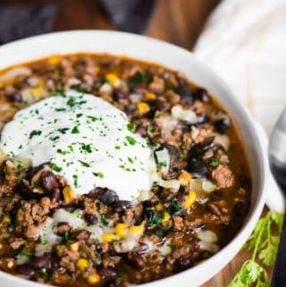 taco chili in bowl with sour cream
