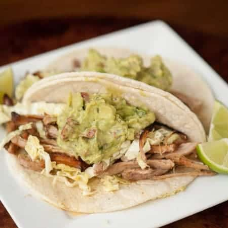 These tasty and fool proof Tailgate Carnitas are slow cooked in the crockpot with green chile and Dr Pepper ahead of time and crisped up hot on game day.