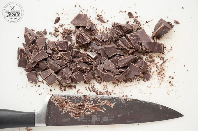 chopped chocolate on white cutting board