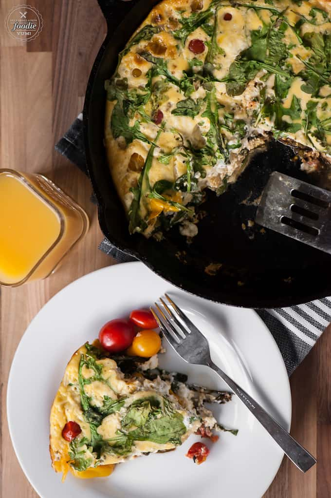 Start your morning off right with this flavorful and healthy protein packed Tomato Arugula Goat Cheese Frittata made with eggs and fresh veggies!