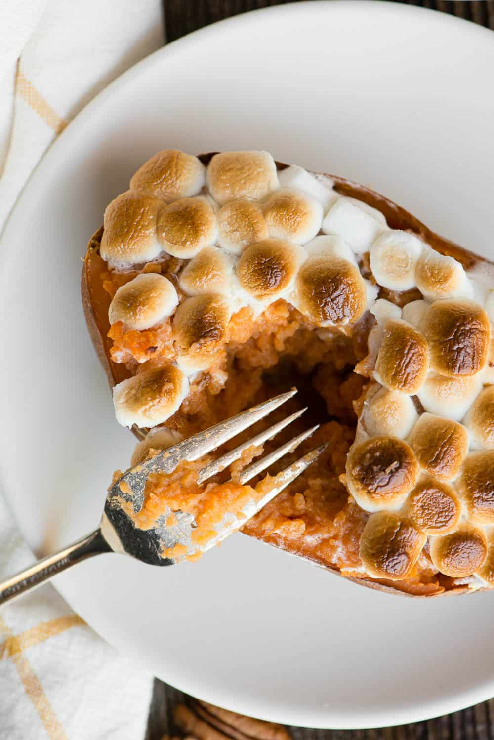 top of a baked sweet potato covered in marshmallows
